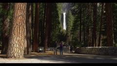 Waterfall, tilt upward along trail, see people, Yosemite Fall Trail