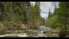 Merced River in Yosemite, raging river water, tilt upwards