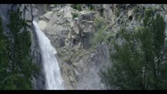 Waterfall flows heavy off cliff, Yosemite