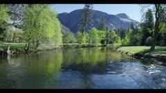 Heavy flowing river, tilt upward to mountain top
