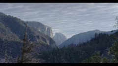 Strong wind pushing trees, winter storm approaches, Half Dome