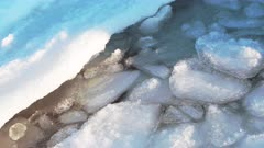 Harbor Ice Chunks Float And Lap Against Shore