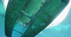 Looking up into a glass bottom boat from below the water's surface in Silver Springs