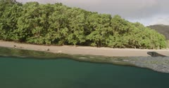 Komodo Dragon swimming / underwater off the coast of Rinca Island, Komodo National Park