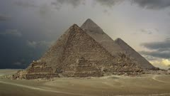 Timelapse with sunset clouds over great pyramids at Giza Cairo in Egypt , 4k