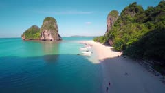 Aerial round 360 degrees view on tropical beach (Pranang beach) and rocks, Krabi, Thailand, 4k
