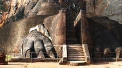 Tourists climb the stairs on Sigiriya Lion Rock Fortress in Sri Lanka, tilt view 4k