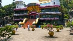 Dambula golden temple in Sri lanka - great buddhistic landmark, tilt view 4k