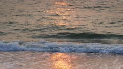 sea waves at sunset on the beach 4k