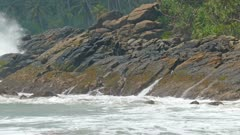 Large ocean waves breaking on the rocks of tropical coast 4k