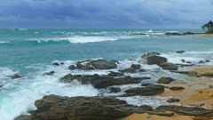 Sea stormy landscape over rocky coastline in Indian ocean 4k