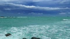 Sea stormy landscape over rocky coastline in Indian ocean 4k