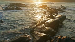 sea waves at sunset on the beach