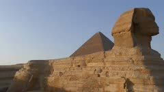 famous ancient Sphinx and Cheops pyramid in Giza Cairo Egypt - pan 4k