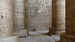 Interior of the painted and carved hypostyle hall at Dendera Temple. Ancient Egyptian temple near Qena. Tilt view