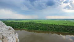landscape with river and rain on horizon - view from height timelapse 4k