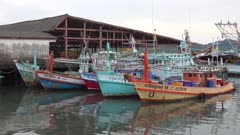 Fishing boats are parked at the pier in Thailand, 4k
