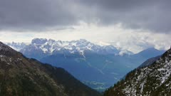 Snow-capped mountains in clouds landscape in alps, Adamello Brenta, Italy, timelapse 4k