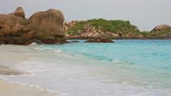 Paradise deserted white sand beach between rocks on Similan islands at morning, Thailand, 4k