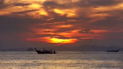 Long tail boats in the sea at sunset, Thailand, 4k
