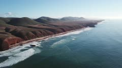 Aerial view on Legzira beach with arched rocks on the Atlantic coast in Morocco, 4k