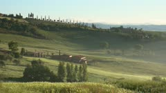 Tuscany landscape at sunrise with farm house and hills, vineyard. Italy. Panorama 4k