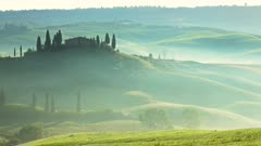 Tuscany landscape at sunrise with farm house and hills, Italy. Timelapse 4k