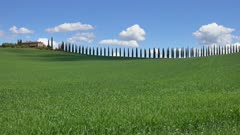Tuscany landscape with farmhouse and cypresses at sunny day. Province of Siena, Italy, 4k