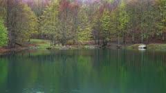 Mountain lake under low clouds at spring, 4k