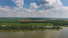 Aerial view of agriculture fields on bank of Danube river in Serbia, 4k