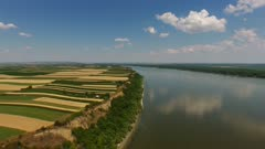 Aerial view of colorful fields on high bank of Danube river in Serbia, 4k