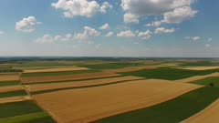 Rural aerial landscape with multicolor agriculture fields in Serbia, 4k