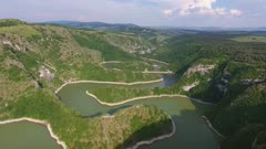 Aerial view of meanders at rocky river Uvac gorge on sunny day, southwest Serbia, 4k