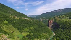 Aerial view on Djurdjevica arch bridge over the Tara River in northern Montenegro, 4k
