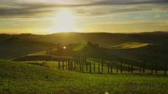 Tuscany landscape with road and cypresses of farmland hill country at sunset. Italy, Europe, timelapse 4k