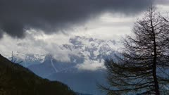 Snow-capped mountains in clouds landscape in alps, Adamello Brenta, Italy, zoom in timelapse 4k