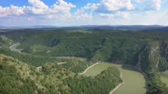 Panorama of meanders at rocky river Uvac gorge on sunny day, southwest Serbia, 4k