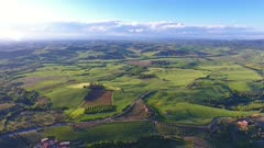 Tuscany aerial landscape of farmland hill country at evening. Italy, Europe, 4k