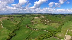 Tuscany aerial landscape with road and cypresses of farmland hill country. Italy, Europe, 4k