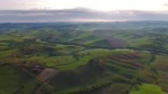 Tuscany aerial sunrise farmland hill country landscape. Italy, Europe, 4k