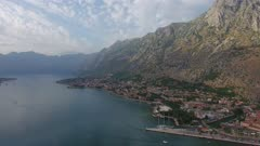 Bay of Kotor (Gulf of Kotor, Boka Kotorska) and walled old city, Montenegro, aerial panorama 4k
