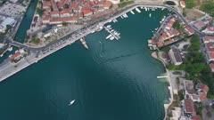 Bay of Kotor (Gulf of Kotor, Boka Kotorska) and walled old city, Montenegro, aerial tilt view 4k