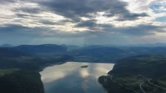 Aerial view of Ribnicko jezero lake in Serbia at sunset, 4k