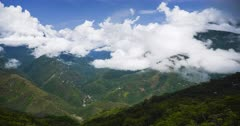Timelapse in Bolivia Andes Mountains scenery, of clouds clearing and weather moving to reveal valley and Amazon rainforest landscape of Bolivian area of South America