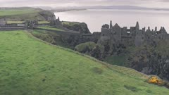 Ruins of Dunluce Castle, Antrim Coast, Northern Ireland. Aerial drone view