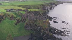 Ruins of Dunluce Castle on the Antrim Coast, Northern Ireland. Aerial drone view
