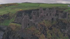 Dunluce Castle ruins on the Antrim Coast, Northern Ireland. Aerial drone view