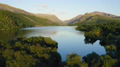 Epic Drone View of Calm Water Lake in Breathtaking Landscape - Aerial Flyover