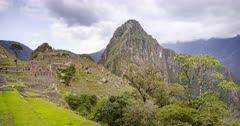 Machu Picchu landscape timelapse of the famous ancient Inca ruins in Peru. Time lapse of clouds over the Incan city with mountains and trees and scenery