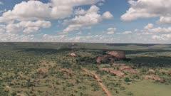 4 wheel drive on safari at Baboon Rock in Laikipia, Kenya. High aerial drone view